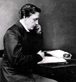 Lewis Carroll at writing desk