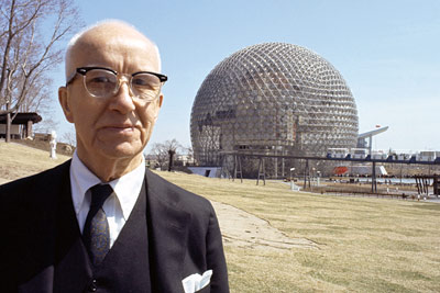 Bucky Fuller standing in front of geodesic dome