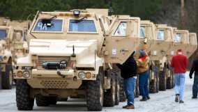 18-ton armored vehicle with gun turrets and bulletproof glass