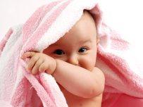 baby_peering_around_blanket